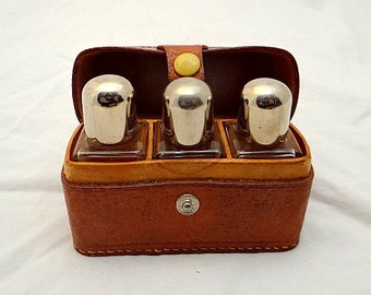 Antique glass bottle,  travel set in leather case