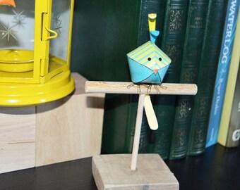 Handmade bird on a bird stand, paper art, unique bird sculpture, nursery decor