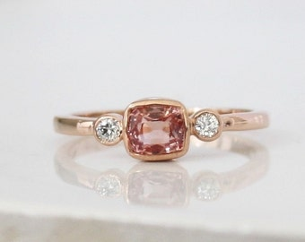 Cushion Padparadscha Sapphire and Diamond 3 Stone Bezel Ring in 14K Rose Gold