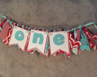 Red and teal high chair banner