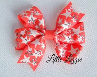 Neon orange star pinwheel hair clip girl toddler