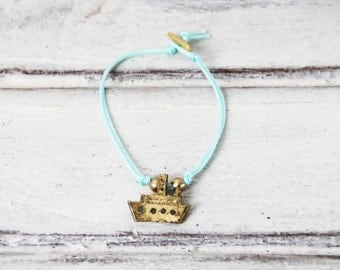 Gold ship bracelet, friendship bracelet, brass, gold plated, ship charm on baby blue cord with gold plated toggle clasp, boho thin bracelet