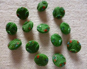 Vintage Buttons.  14 Green Glass Buttons from 1940's, with red black and blue highlights.