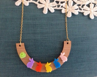 Colorful bunny necklace on wood