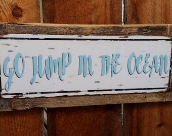 Go Jump in the Ocean metal street sign
