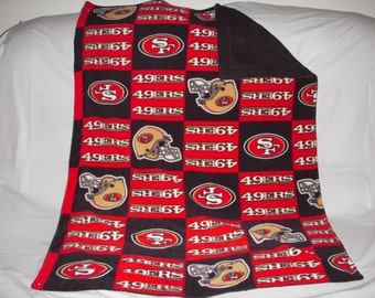 Pet Blanket - sporty red and gold San Francisco 49ers print fleece with solid black fleece on the reverse side.