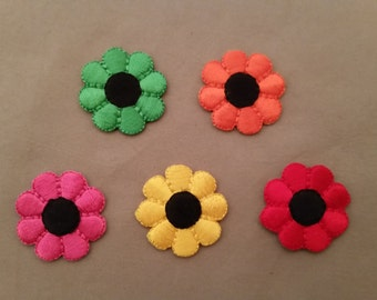 small embroidered daisy patches.