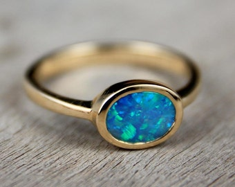 Black Opal Engagement Ring 14K Solid Gold  East to West Solitaire SKU: 7x5-E-W