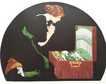 1912 Vintage print by C Coles Phillips - fadeaway girl woman in black dress against black background
