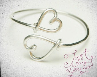Two hearts ring...