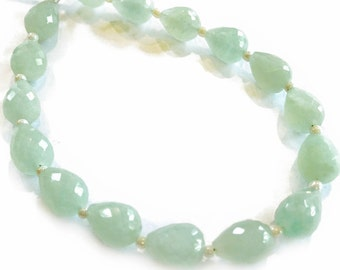 Aquamarine faceted teardrops, length-drilled.  Approx. 6.25x8mm.   (1 bead)