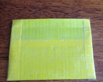 Yellow duct tape coin pouch