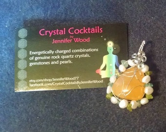 Orange Calcite with Peridot, Aatite and Pearl pendant
