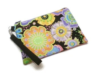 Funky floral iPhone 6 plus double zippered wallet wristlet. Fits iPhone and Samsung phones with credit card slots.