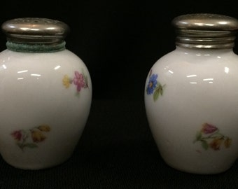 White Salt and Pepper Shakers With Floral Design