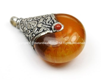 Reversible Tibetan Amber Resin Pendant with Tibetan Silver Caps, Repousse Lotus Flower Details & Red Colored Coral Inlays- WM5679A-1