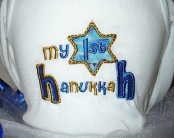 Baby's first Hanukkah body suit, shirt, bib or burpcloth.