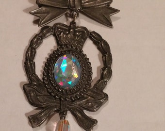 Vintage Pewter? Brooch with aurora borealis faux stone in center.