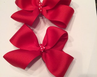 Set of red grosgrain ribbon bows with alligator clips