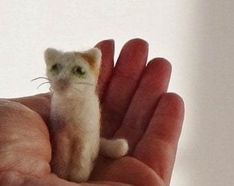 Miniature needle felted calico cat