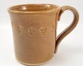 Handmade pottery Mug ceramic - handmade skulls honey amber pottery ceramic coffee mug stamped with skulls and hands.