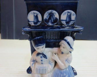 Two Delft Kids Playing Under The Mantle Playing Music