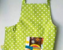 Easy to put on kids apron Ready to ship With Velcro clothing around waist and elastic neck strap Washable With one colorful pocket For kids