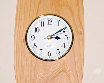 Wall clock. Cherry wood and a quartz movement.