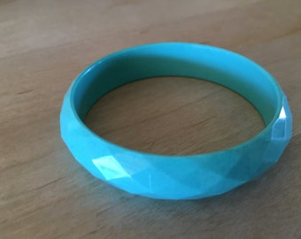 Teal Colored Acrylic Etched Bracelet