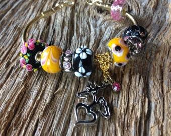 Browning buck and doe bracelet: browning deer infinity knot elegant bracelet for wife or girlfriend, yellow, black and pink deer, deer love