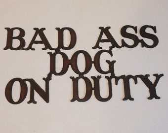 Bad Ass Dog on Duty sign made out of rusted metal
