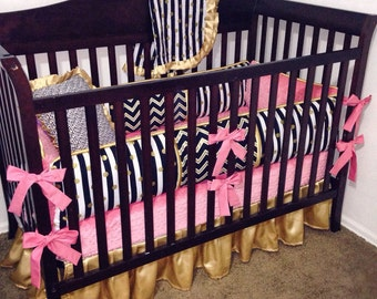 Black stripe, coral, gold bedding, bumpers, crib skirt, sheet, gold and black chevron