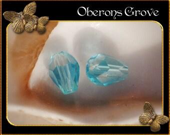 10 aqua blue coloured tear drop beads 4x6mm