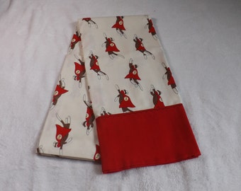 Pillow case made from flying sock monkey super hero cotton fabric with red trim with black decorative tread