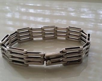 "Contemporary sterling silver bracelet, 8.5"" x 3/4"", 34.4g"