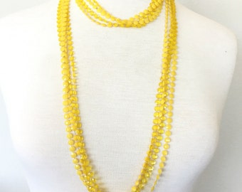 Yellow plastic multistrand necklace