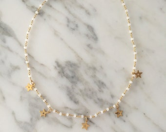 Rosary necklace with golden stars.