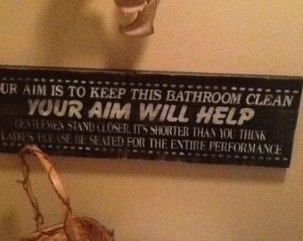Hand painted wooden sign our aim is to keep this bathroom clean your aim will help, distressed
