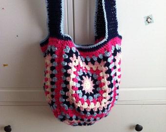 Handmade crochet market bag in blues and pinks