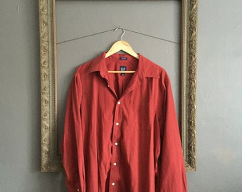 red long-sleeve button-down shirt
