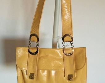 Vintage yellow shoulder patent leather handbag 1970's Austin Power look.
