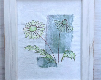 Free machined flower motif mounted in distressed wooden frame