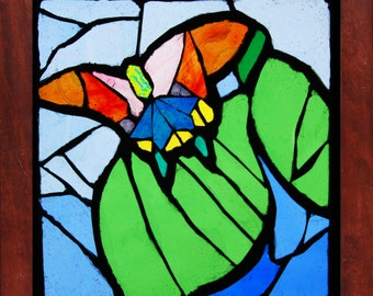 stained glass mosaic butterfly and leaf
