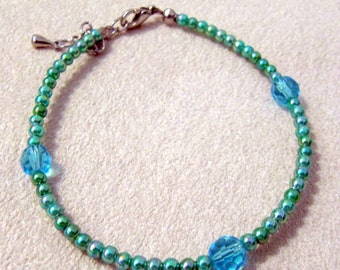 Teal beaded bracelet with 3 crystal beads
