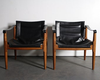 Two Stylish Mid Century Teak and Wrapped Leather Safari Chairs