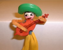 Vintage Celluloid Pipe Cleaner Mexican Guitar Player Man Pin Brooch (E88)