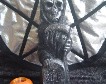 Candle grim reaper with a scythe Halloween