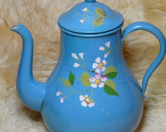 Pot bellied French enamel coffeepot with raised pattern of blackberry flowers