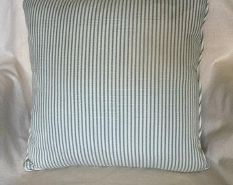 green and white stripe pillow