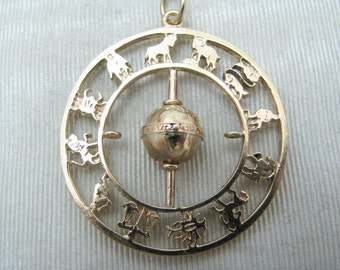 Unique Circular Zodiac Calendar with Spinning Ball In Middle in 14k Yellow Gold